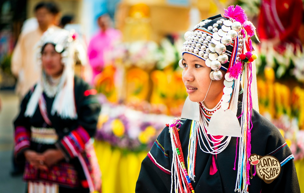 Chiang Mai, Thailand - February 6, 2016: Chiang Mai, Thailand - February 6, 2016: Ayoung Akha woman waits for the start of the annual flower parade in Chiang Mai, Thailand.