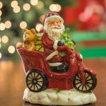 Mikołaj na skuterze- figurka LED z pozytywką